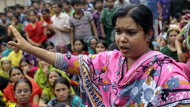 A Bangladeshi worker participates in a protest outside a garment factory in Dhaka, Bangladesh, on Sunday. Hundreds of garment workers demanded better  conditions. (AP)