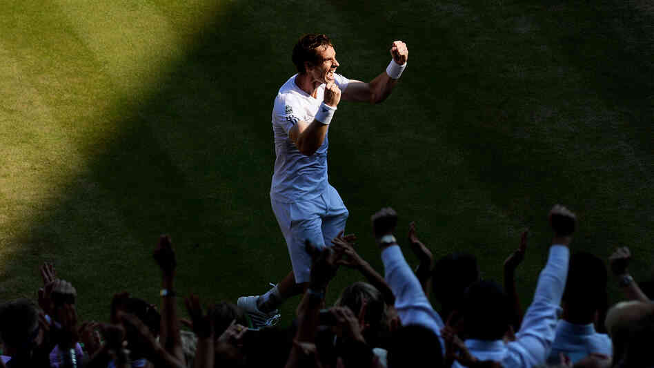 Britain's Andy Murray celebrates after defeating Novak Djokovic of Serbia at Wimbledon on Sunday in London. Murray was the first British man to win Wimbledon in 77 years.