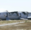 National Transportation Safety Board officials handed out this photo of the burnt shell of Asiana Flight 214 during their first assessment of the crash. Two people died Saturday and scores more were injured.
