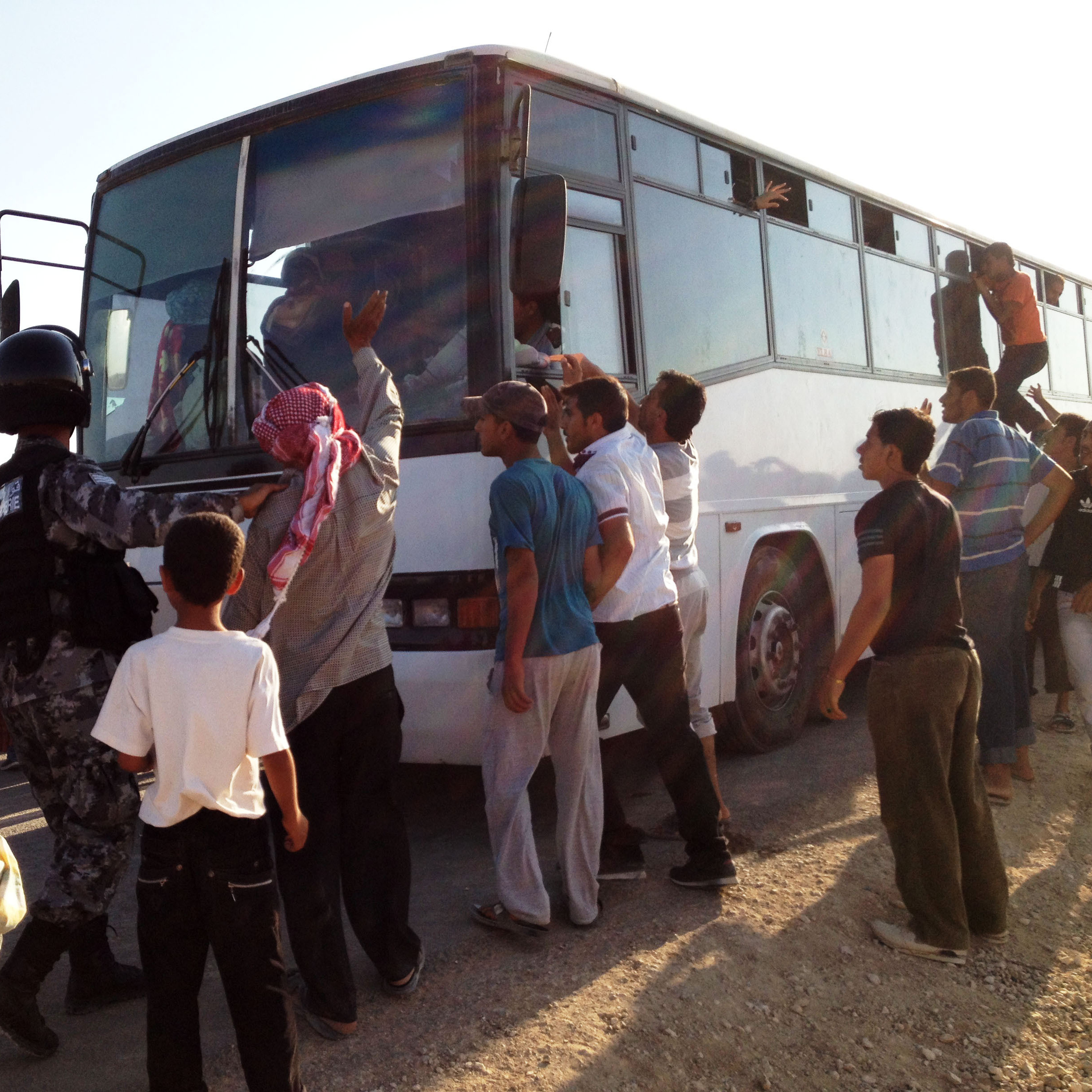 After flooding into Jordan for the past two years, some Syrian refugees are now heading home even though the country's civil war is still raging. Here, Syrian refugees board a bus for home at the Zaatari refugee camp in Jordan.