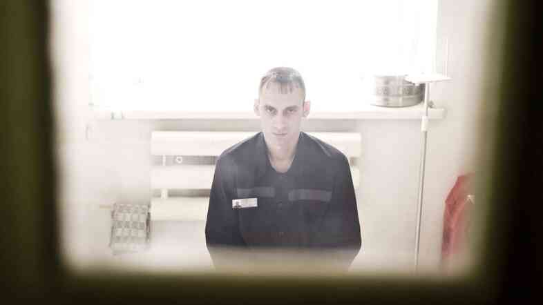 Igor Davydenko sits in his cell at a Siberian prison where inmates are treated for drug-resistant tuberculosis.