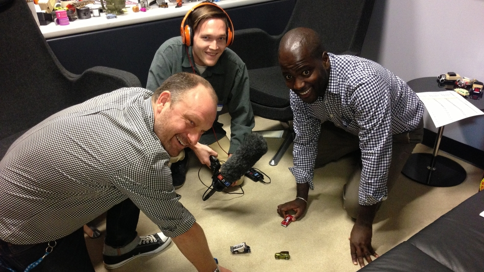Felix Holst, left, is the head designer of Hot Wheels and Matchbox cars for Mattel. Holst demonstrates some of his team's designs to Aaron Schrank, center, and Sonari Glinton.