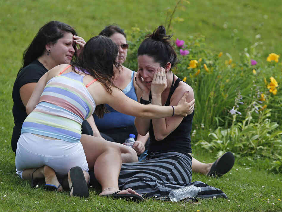 Comforting each other: A group of young women in Lac-Mégantic, Quebec, on Sunday. People there are waiting to hear the fate of 40 people still