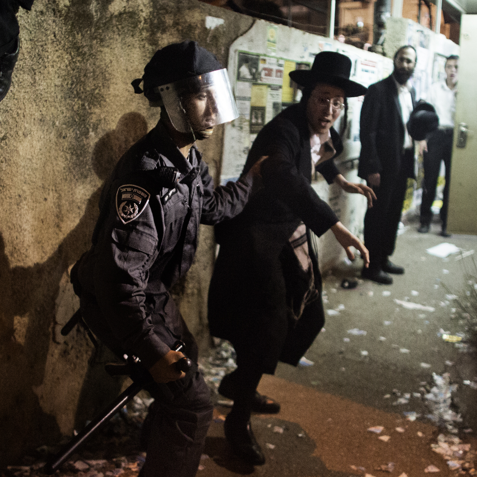 An Israeli police officer arrests an Ultra-Orthodox Jew during a protest against the draft law in Jerusalem on May 16.