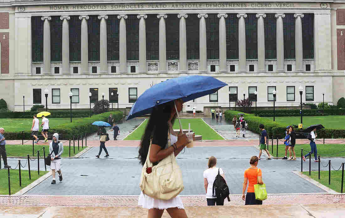 People walk on the Columbia University campus in New York City on July 1, the da