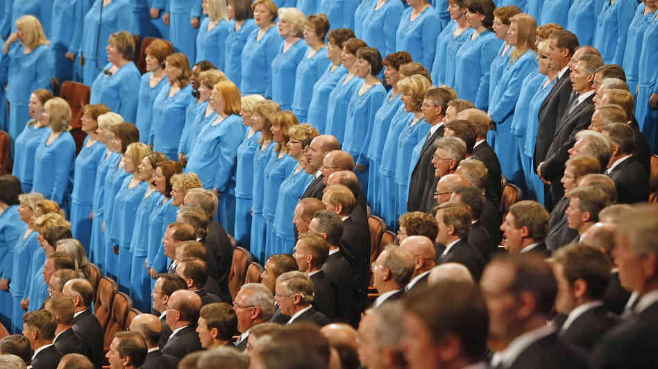 Members of the Mormon Tabernacle Choir raise their voices in unison — and perhaps unify their heart rates, too.