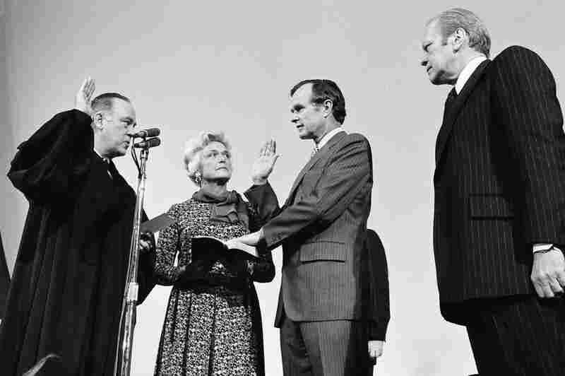 George Bush is sworn in as director of the Central Intelligence Agency on Jan. 30, 1976, by Supreme Court Associate Justice Potter Stewart (left) as Mrs. Bush and President Gerald Ford watch at CIA headquarters in Langley, Va. Bush succeeded William Colby, who retired.