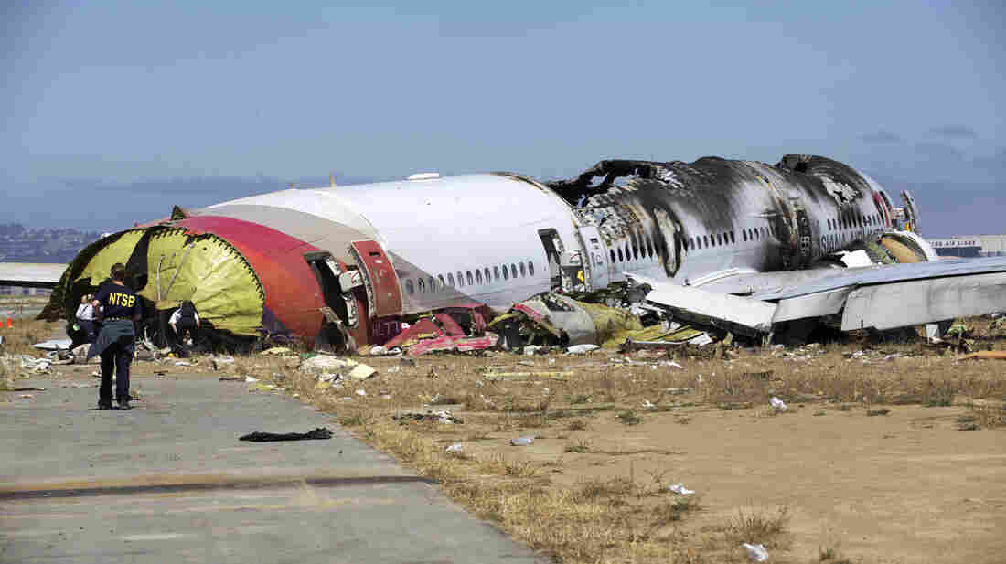 NTSB investigators at the scene of the Asiana Flight 214 crash in San Francisco.