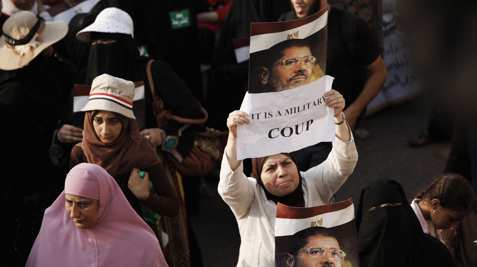 Egypt's military and the nation's interim leaders say the ouster of President Mohammed Morsi was not a coup, but rather a response to public demand. Morsi's supporters believe otherwise.  If it was judged to be a coup, the U.S. might have to cut off aid to Egypt's military. (Ed Giles/Getty Images)