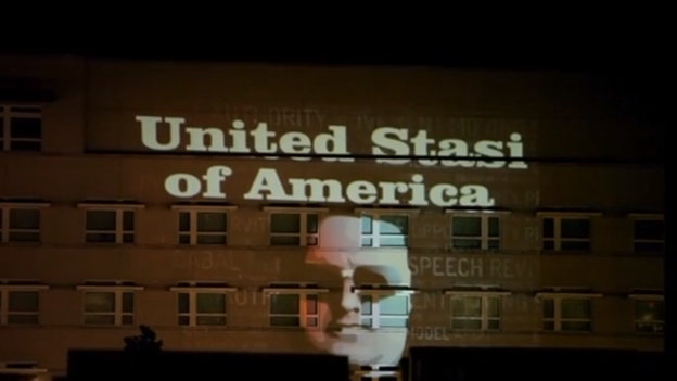 German activists used a light projection on the U.S. Embassy in Berlin in the pre-dawn hours of Sunday. The Stasi were the former East German police who spied on citizens during the communist era.