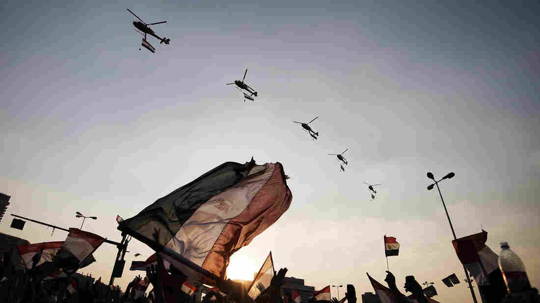 Egyptians wave their nationa