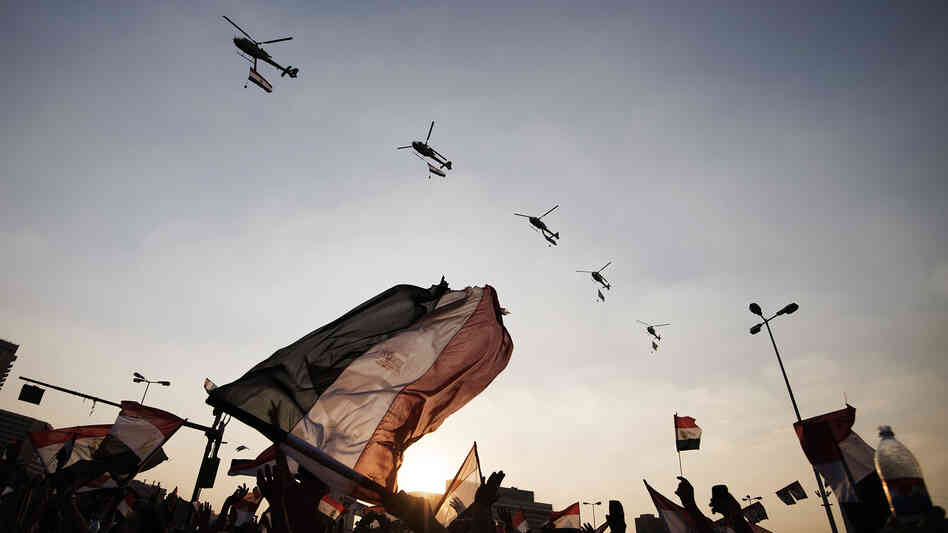 Egyptians wave their national flag as army helicopters fly over Cairo's Tahrir Square on July 4, the day after the military ousted President Mohammed Morsi. Egypt's military receives $1.3 billion annually from the U.S.