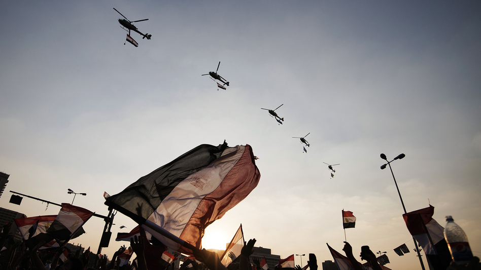 Egyptians wave their national flag as army helicopters fly over Cairo's Tahrir Square on July 4, the day after the military ousted President Mohammed Morsi. Egypt's military receives $1.3 billion annually from the U.S. (Gianluigi Guercia/AFP/Getty Images)