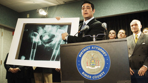 Assistant District Attorney Josh Hanshaft holds an X-ray of the pelvic area of a deceased person with PVC pipe inserted where bones should have been. The image was shown during a New York announcement of indictments of four individuals, including Michael Mastromarino, in 2006.