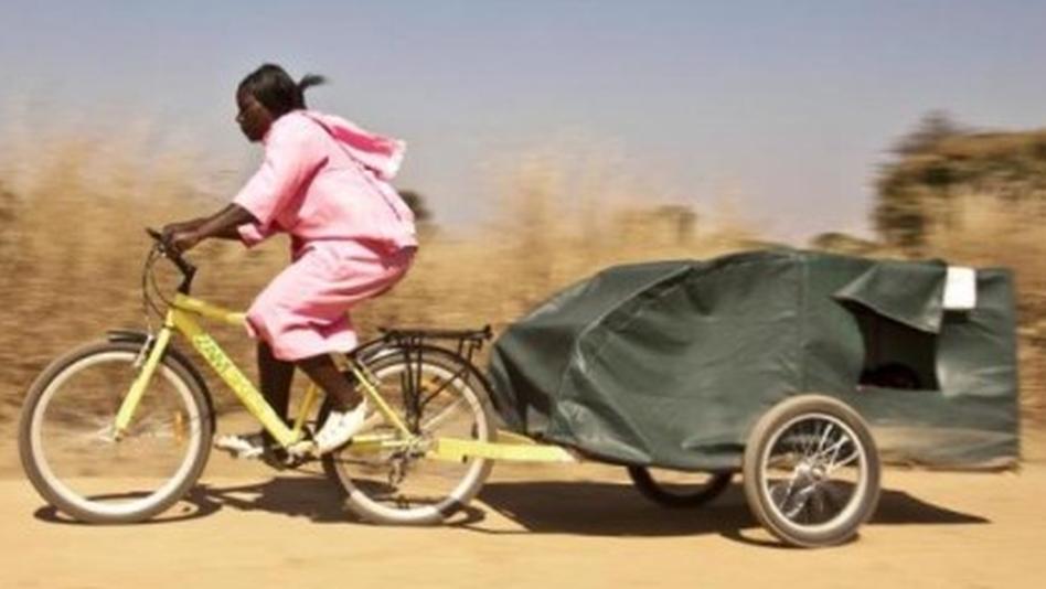 Bike ambulance driver Grace Kakyo transports a patient in northern Uganda. (Photo courtesy CA Bikes)