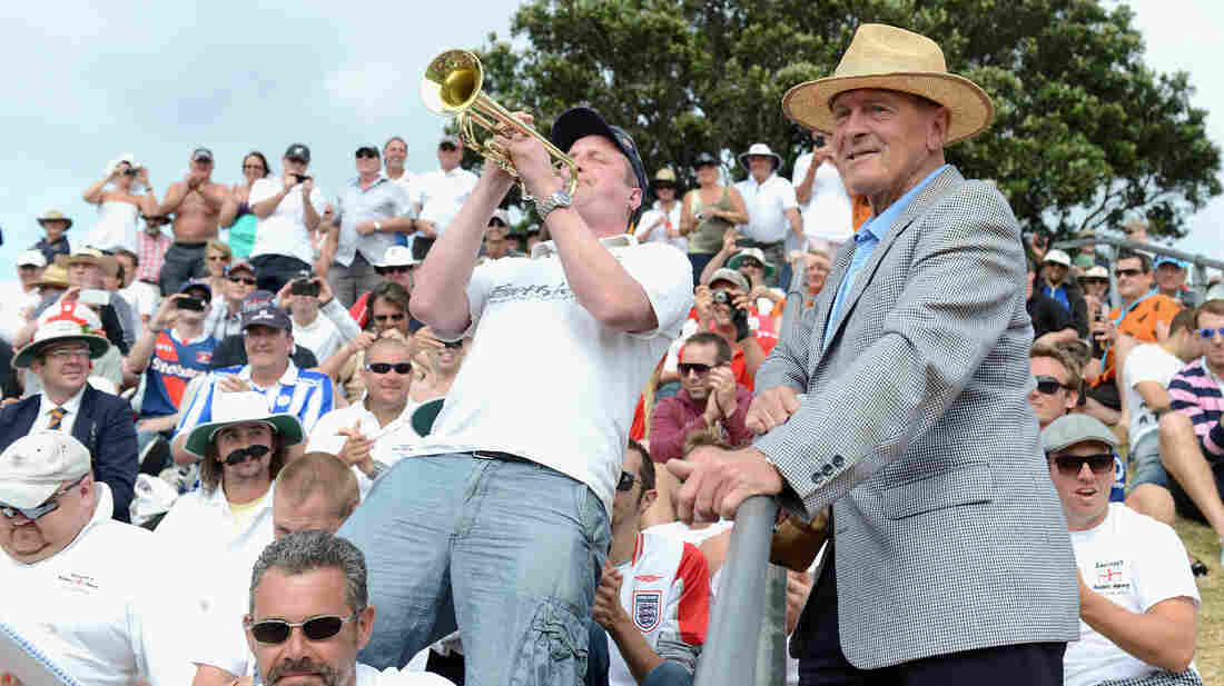 Former England cricketer Geoffrey Boycott listens to Barmy Army trumpeter Billy Cooper during the second test between New Zealand and England at Basin Reserve on March 15 in Wellington, New Zealand. Cooper's trumpet will be silent at Trent Bridge, in Nottingham, England, because the ground doesn't allow musical instruments.