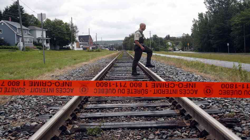 Do not cross: Crime scene tape blocks access to part of Lac-Mégantic, Quebec, where a train derailed and exploded on Saturday.