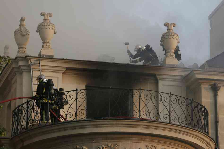 Firemen battle flames at the 17th century Hotel Lambert early Wednesday in Paris.