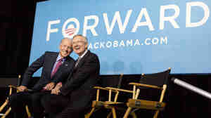 Vice President Biden (left) and Senate Majority Leader Harry Reid of Nevada react to cheers from the crowd at a campaign rally on Oct. 18, 2012, in Las Vegas.