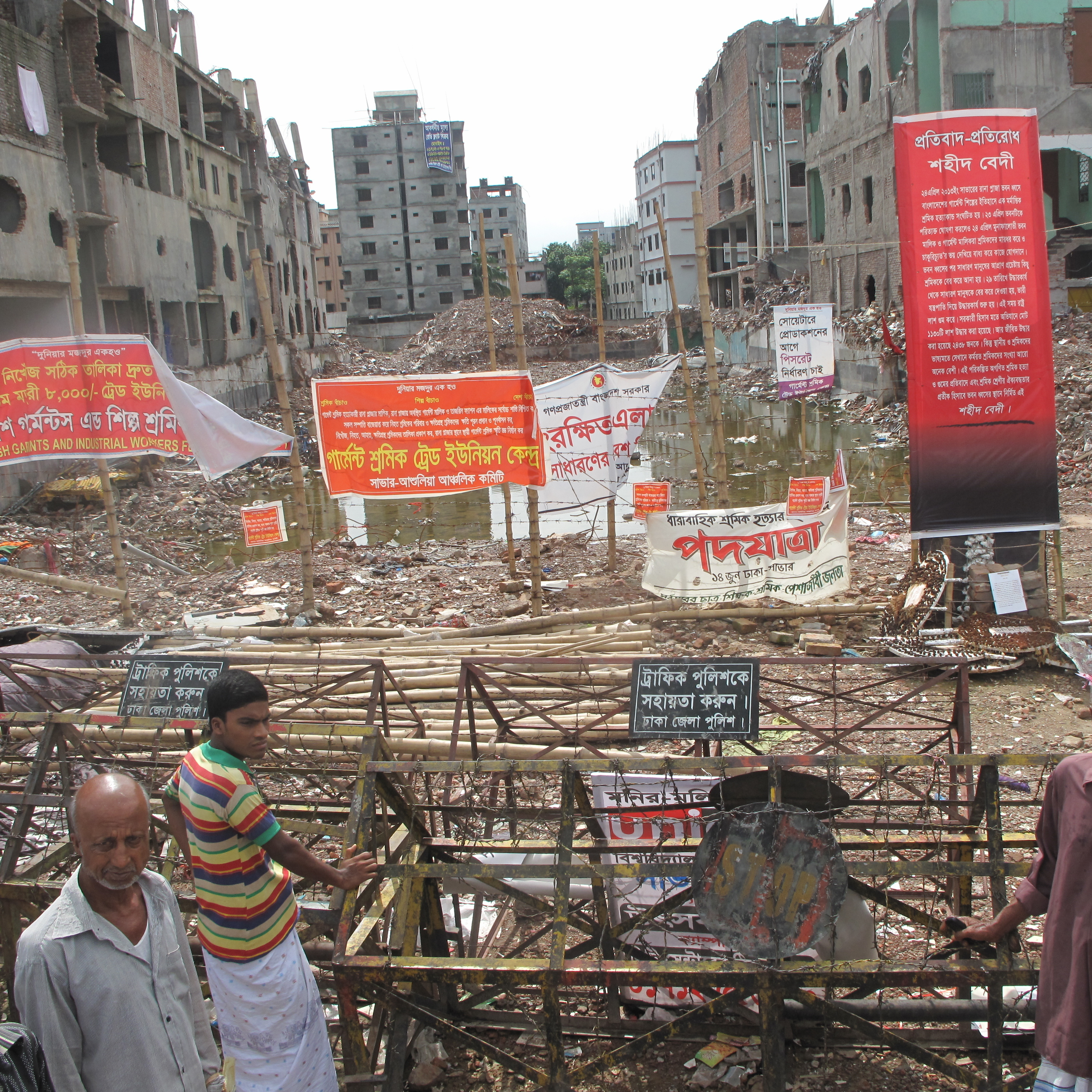 The gap between the buildings is where the Rana Plaza stood until a few months ago. More than 1,000 people were killed when the building collapsed April 24. It was the worst disaster in the garment industry's history.