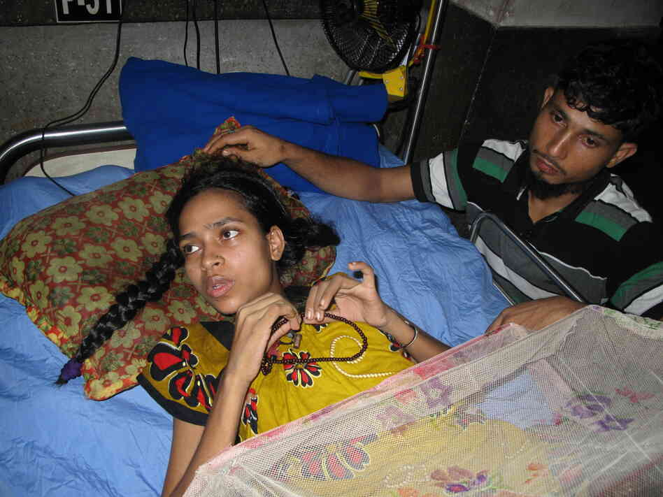 Rebecca Khatun, a worker at Rana Plaza, lies in a hospital bed. She lost her left leg and right foot in the collapse, which also killed five members of her family. Khatun received $