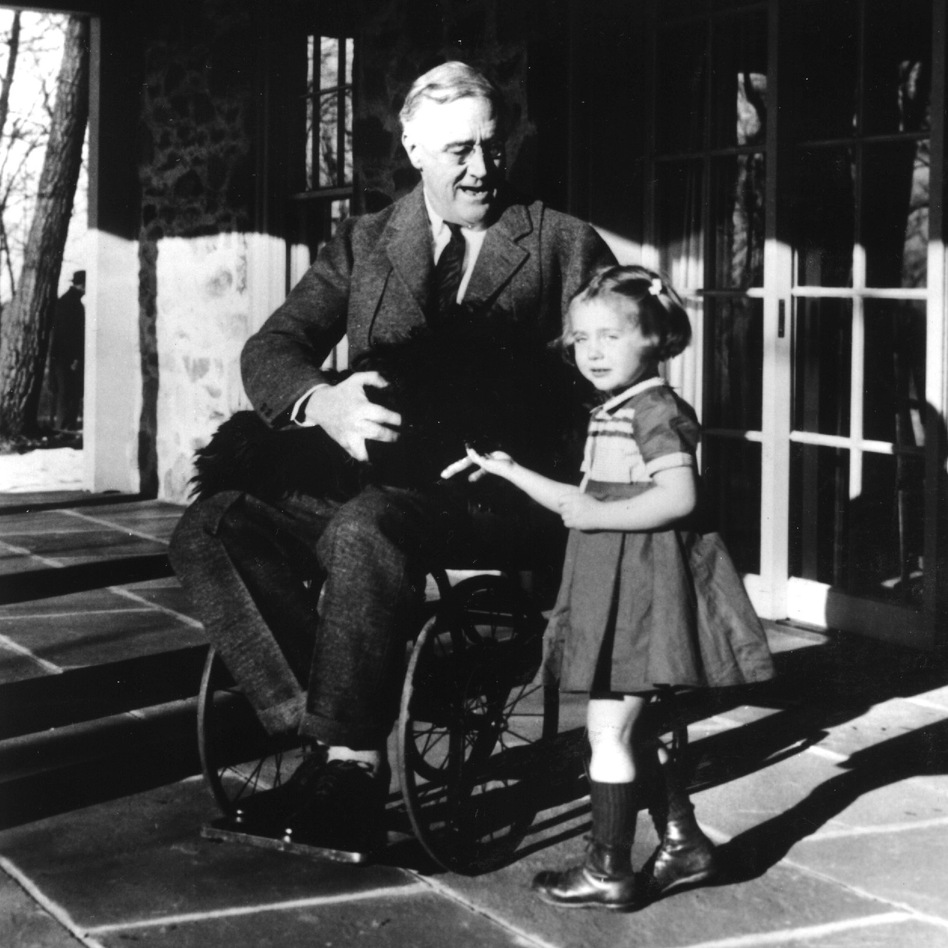 Photos of President Franklin D. Roosevelt sitting in a wheelchair are also rare and weren't shown to the public while he was in office. In this image from 1941 he's with his dog Fala and Ruthie Bie, the granddaughter of a gardener who worked for the Roosevelt family. (Landov)