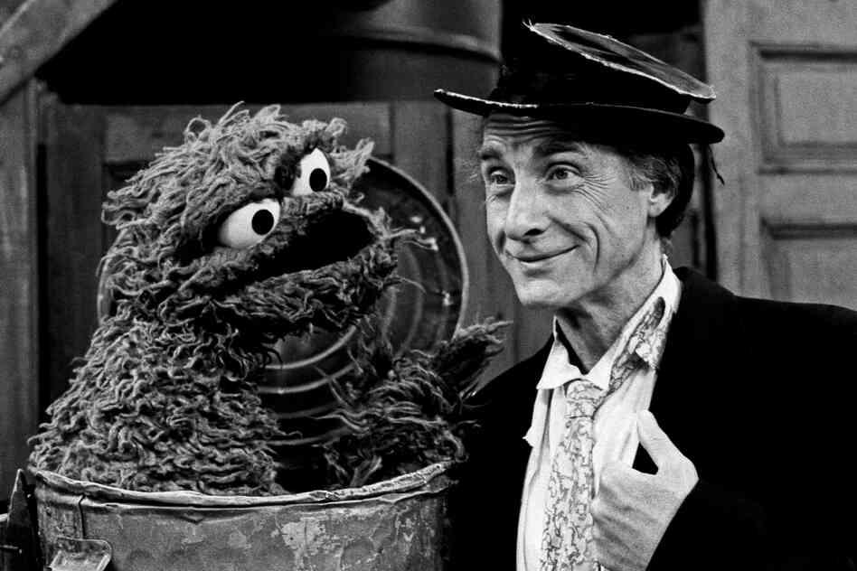"""Caesar portrays his classic """"professor"""" in a guest appearance for Sesame Street's 15th anniversary season in 1985."""
