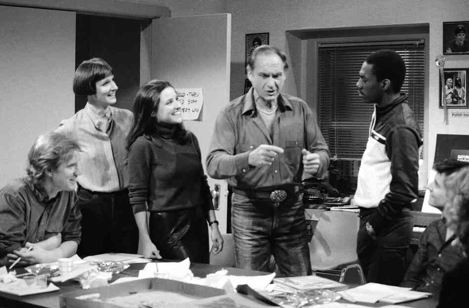 Caesar with Saturday Night Live writer Brad Hall (from left), Mary Gross, Julia Louis-Dreyfus, Eddie Murphy and Gary Kroeger on the set of Saturday Night Live in 1983 in New York.