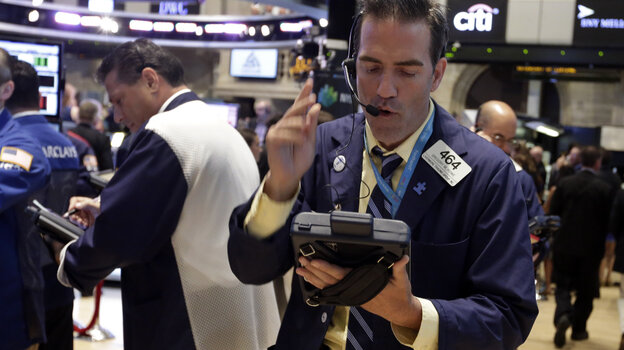 Traders work at the New York Stock Exchange Wednesday. Stocks rose in the moments after details of the Federal Reserve's latest policy meeting were released today.