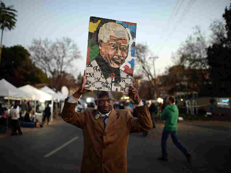 People gather to leave messages of support for Nelson Mandela outside his hospital in Pretoria, South Africa, earlier this year. Mandela has died at the age of 95.