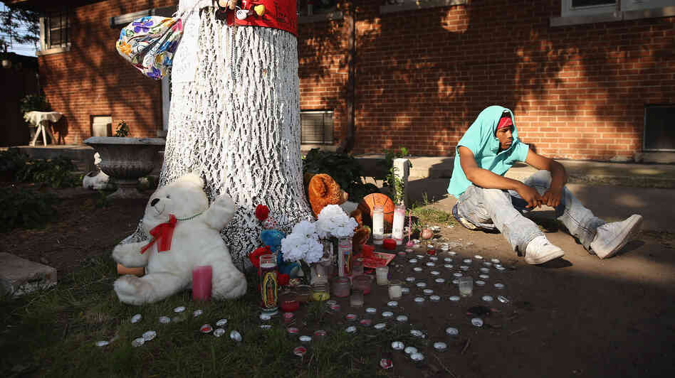 Homicide remains a leading cause of death for young people, even as rates drop. In Chicago, a teenage boy grieves next to a memorial where Ashley Hardmon, 19, was shot and killed on July 2. Gunmen fired while she was chatting with friends.