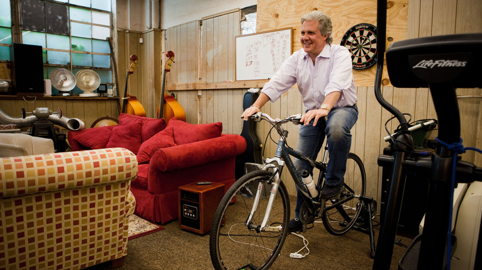 Michael Pagliaro pedals on a stationary bike in the warehouse of his business in Dobbs Ferry, N.Y. Working out is fun again now that his hip doesn't hurt.