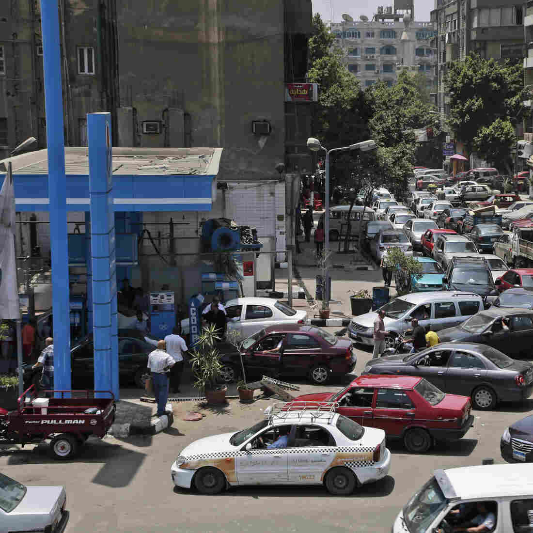 Egyptian drivers wait in long lines outside a gas station in Cairo on June 26. Along with a stuttering economy, traffic-clogging street protests and a crime wave, fuel shortages have come to symbolize the disorder of the post-Mubarak Egypt.