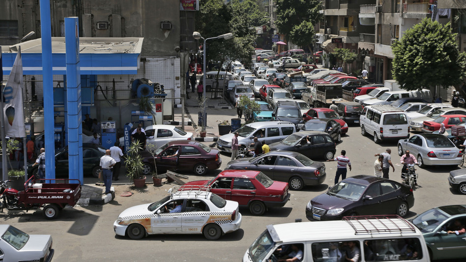 Egyptian drivers wait in long lines outside a gas station in Cairo on June 26. Along with a stuttering economy, traffic-clogging street protests and a crime wave, fuel shortages have come to symbolize the disorder of the post-Mubarak Egypt. (AP)