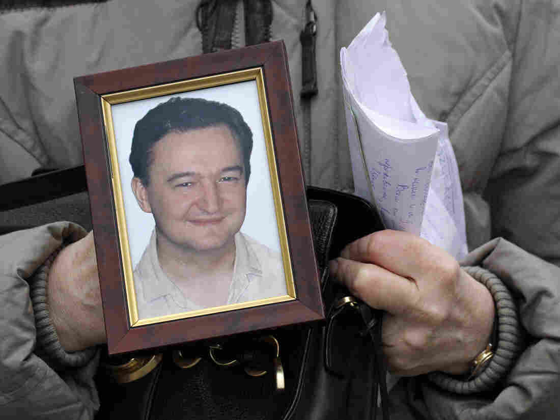 Sergei Magnitsky's mother, Nataliya Magnitskaya, holds a photo of her late son in 2009.