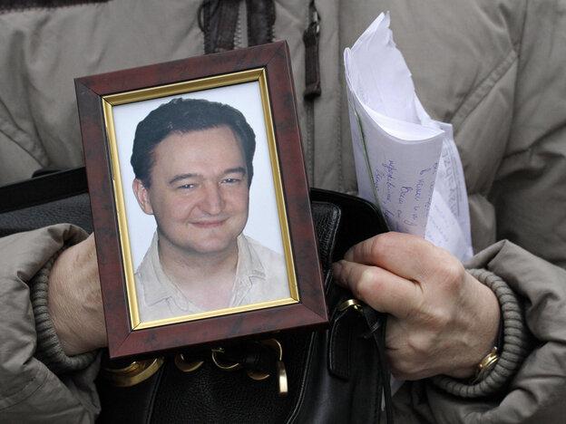 Sergei Magnitsky's mother, Nataliya Magnitskaya, holds a photo of her late son in 2009.