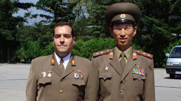 Spanish aristocrat Alejandro Cao de Benos is believed to be the only foreigner working for the North Korean government. He divides his time between North Korea and Europe, where he organizes university conferences on North Korean ideology. He's shown here with a North Korean military officer in Panmunjon, on the border with South Korea. (Courtesy of Alejandro Cao de Benos)