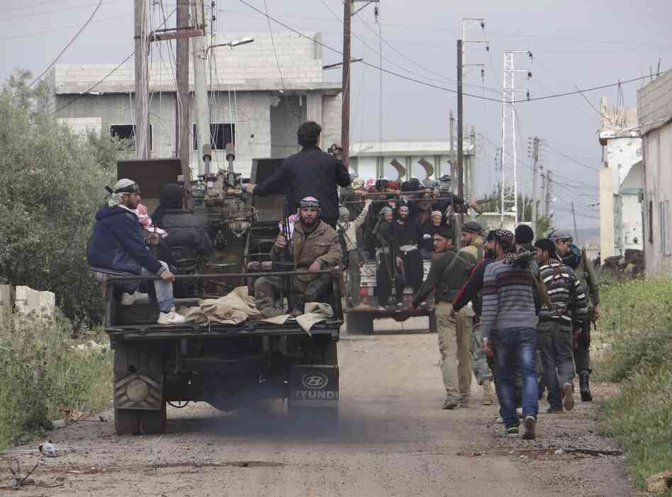 Rebels of the Free Syrian Army move toward the front line in Dera'a, Syria, on April 18.