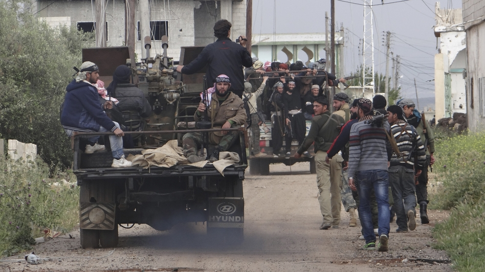 Rebels of the Free Syrian Army move toward the front line in Dera'a, Syria, on April 18. (Reuters/Landov)