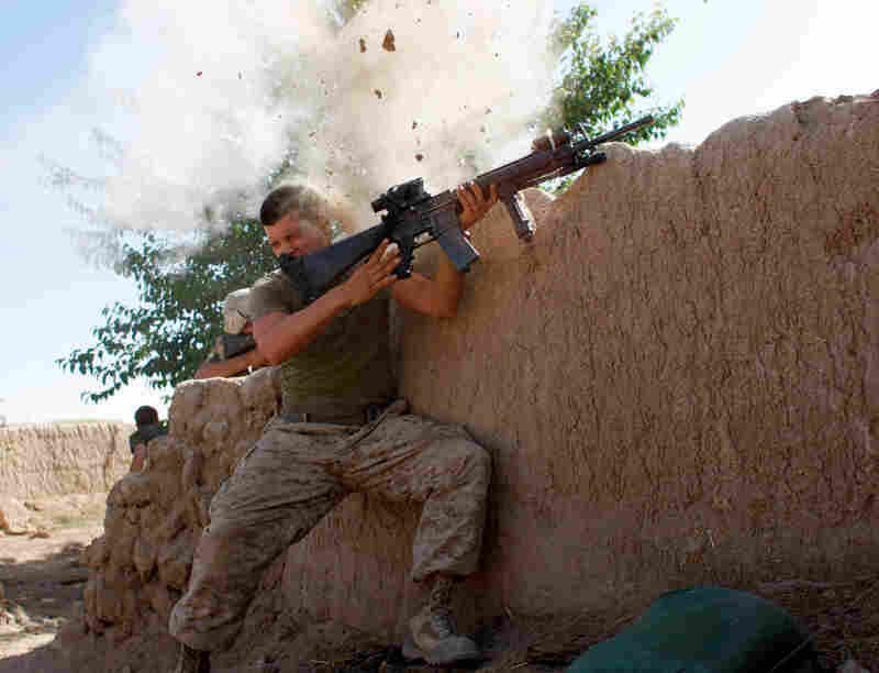Sgt. William Olas Bee, a U.S. Marine from the 24th Marine Expeditionary Unit, has a close call as Taliban fighters open fire near Garmsir in Helmand province, Afghanistan, 2008.