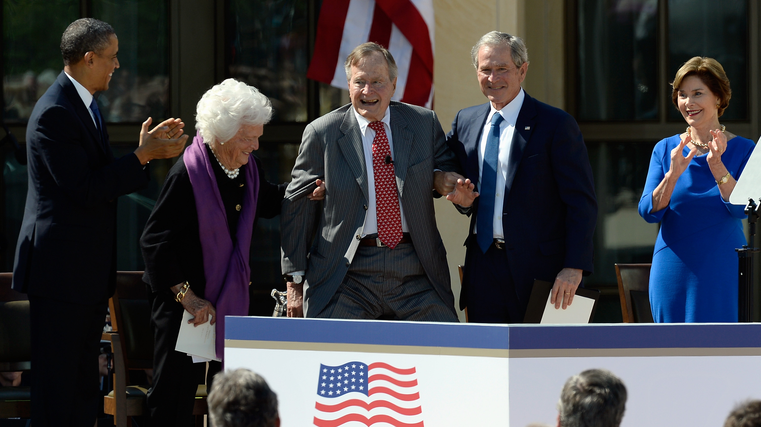 In Second Term, Obama Takes Softer Tone Toward Bushes