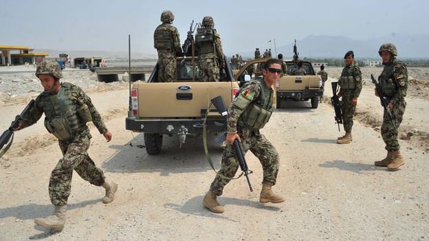 Afghan soldiers take positions following a clash with Taliban fighters on the outskirts of the eastern city of Jalalabad on July 7. The U.S. is trying to organize peace talks, but the latest effort has been put on hold while the fighting continues. (Getty Images)