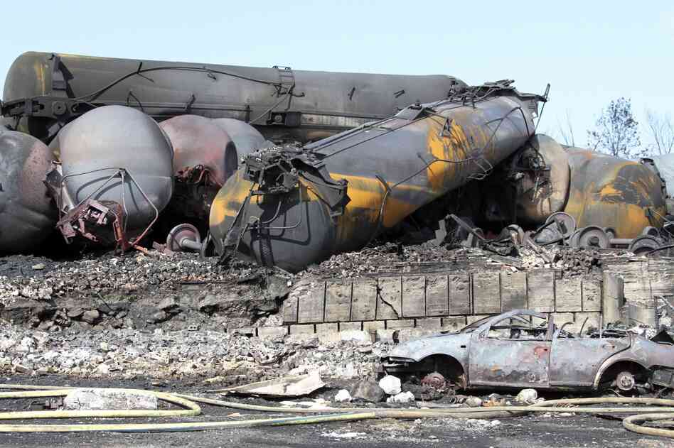 A police photograph shows burned and wrecked crude oil carrying rail tankers piled up in Lac-Megantic, Quebec, on Monday. Dozens of people died in the disaster.