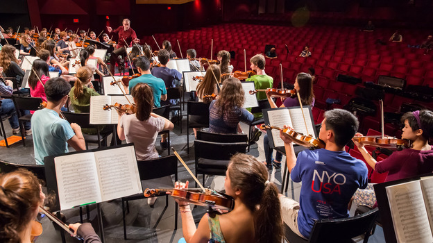 Conductor Valery Gergiev leads the National Youth Orchestra through its first rehearsal with the maestro, at Purchase College outside New York City. (Chris Lee)