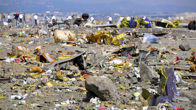 Debris left behind by the crash-landing of Asiana Flight 214, released by the NTSB this week. Police officials say a teenager who died at the airport was hit by a fire truck on the runway; she had been covered by firefighters' foam. (NTSB)