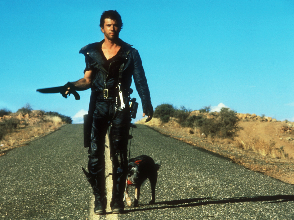 We see a fictional universe stripped of the most basic resources when Mel Gibson's character relishes a can of dog food in Road Warrior. (The Kobal Collection)
