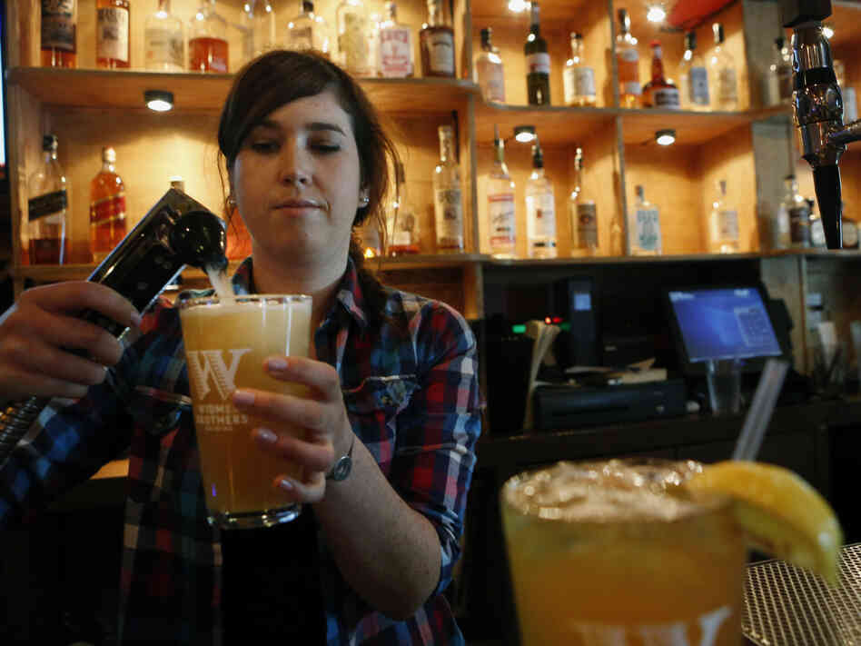 "Megan Horrigan mixes a shandy at Union Pub in Washington, D.C. ""It's refreshing, great for the summer,"" says customer Tom Tupa, who sampled the drink."
