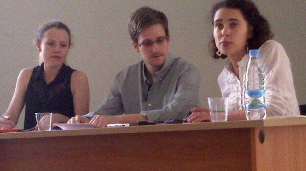 Edward Snowden, center, at Moscow's Sheremetyevo Airport on Friday. At left is WikiLeaks' Sarah Harrison. The woman at right is unidentified at this time.