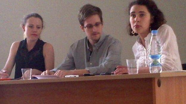 Edward Snowden, center, at Moscow's Sheremetyevo Airport on Friday. At left is WikiLeaks' Sarah Harrison. The woman at right is unidentified at this time. (Courtesy of Human Rights Watch)