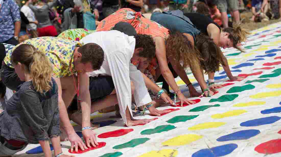 Festivalgoers play a giant game of Twister during the Glastonbury Festival of Contemporary Performing Arts in southwest England last month.